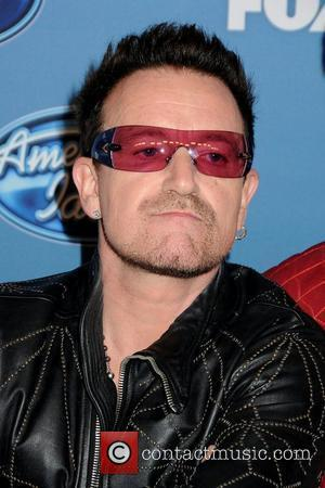 Hitch-hiking Bono Picked Up By Ice Hockey Star