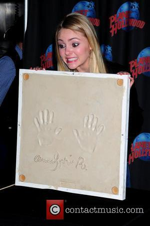 AnnaSophia Robb promotes her starring role in 'Soul Surfer' with an appearance at Planet Hollywood Times Square New York City,...