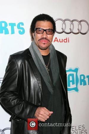 Lionel Richie  16th Annual Los Angeles Antiques Show 2011- Arrivals Santa Monica, California - 13.04.11