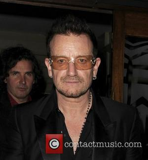 U2 singer Bono leaving Balans in Soho in the early hours of the morning. London, England - 14.09.11