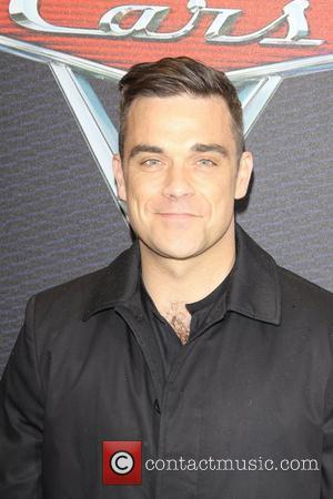 Robbie Williams Relaunches Solo Career With New Record Deal
