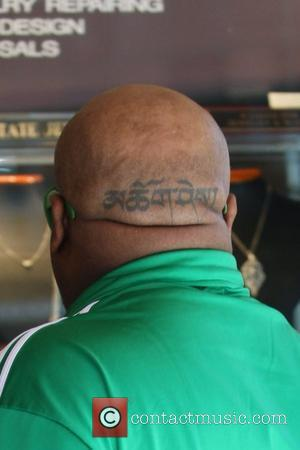 Cee Lo Green's head tattoo Cee Lo Green leaving a medical centre in Beverly Hills wearing a green Adidas tracksuit...