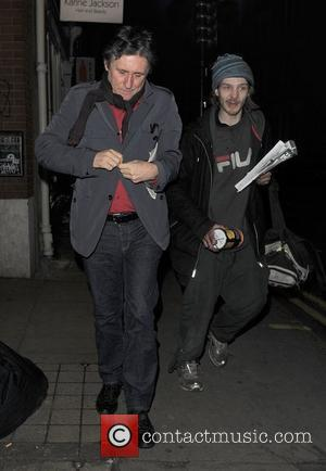 Gabriel Byrne leaving The Ivy restaurnt after having dinner with Elle MacPherson. Elle was driven home in a private car,...