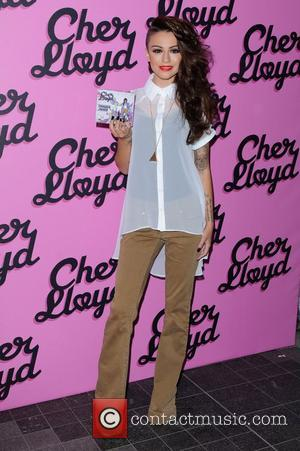 Cher Lloyd X Factor rapper and singer meets fans and signs copies of her debut single, Swagger Jagger at HMV...