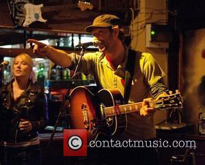 Martin & Paltrow Take Tube To Coldplay Gig