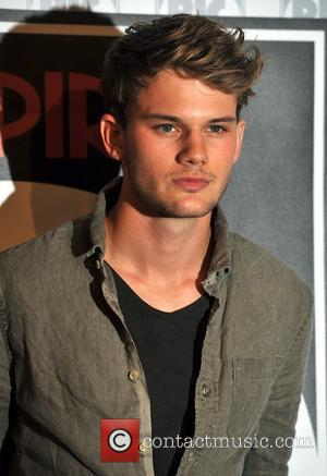 Jeremy Irvine poses for photographers before an 'Empire Big Screen' interview at the O2 Arena. London, England - 14.08.11