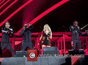 Black Eyed Peas Raise $4 Million With Rain-soaked Charity Concert