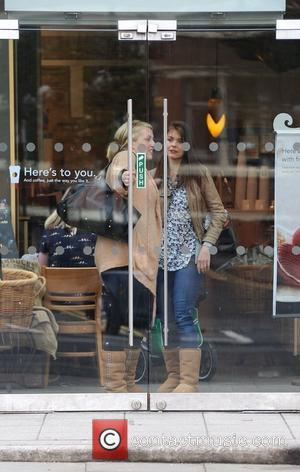 Coronation Street star Kate Ford and a companion outside Starbucks Manchester, England - 06.04.11