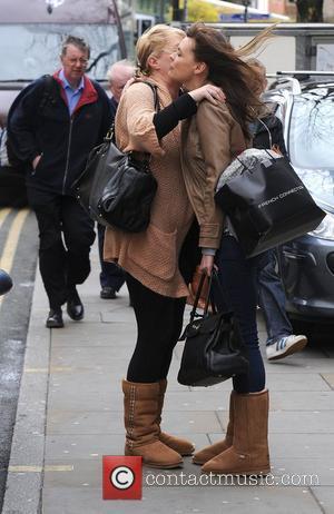 Coronation Street star Kate Ford and a companion hug outside Starbucks Manchester, England - 06.04.11
