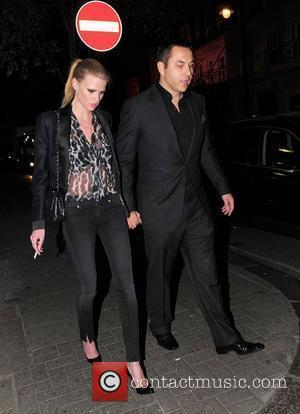 David Walliams and Lara Stone holding hands as they walk outside Nobu London, England - 19.04.11