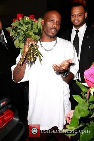 DMX aka Earl Simmons rapper holding a bouquet of roses while leaving The Colony after attending a Maxim magazine party...