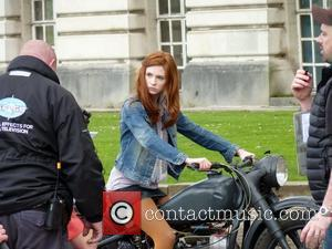 Karen Gillan rides on a motorcycle on the set of the BBC sci-fi series Doctor Who filming on location at...