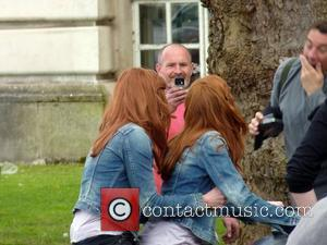Karen Gillan and her stunt-double ride on a motorcycle on the set of the BBC sci-fi series Doctor Who filming...