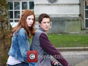 Arthur Darvill and Karen Gillan ride on a motorcycle on the set of the BBC sci-fi series Doctor Who filming...