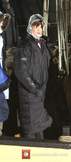Matt Smith sporting a plastic rain bonnet on the film set of 'Dr Who' shooting on location in Cornwall Cornwall,...
