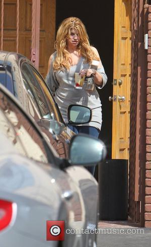 Kirstie Alley Enlists The Help Of Travolta