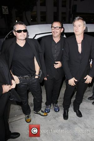 Rocker J.d. Fortune Caught Up In Inxs Tour Photo Mix Up
