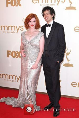 Christina Hendricks and Geoffrey Arend, at the 63rd Primetime Emmy Awards, held at Nokia Theatre L.A. LIVE - Arrivals Los...