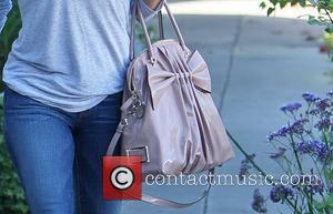 Eva Longoria departs the Ken Paves salon in West Hollywood carrying a pink Valentino handbag Los Angeles, California - 13.10.11