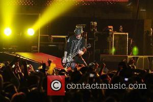 Guitarist/ songwriter Dj Ashba of Guns N' Roses performs at the American Airlines Arena during his North American Tour...