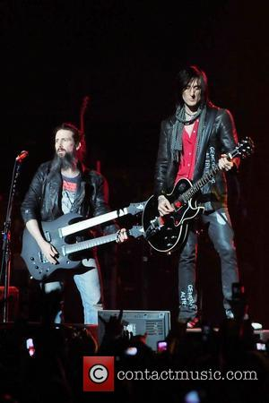 Ron Bumblefoot Thal and Richard Fortus of Guns N' Roses performs at the American Airlines Arena during his North American...