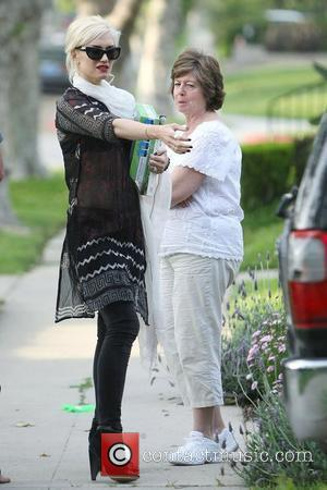 Gwen Stefani leaving her mother's home carrying the Jean Harlow book, 'Harlow in Hollywood: The Blonde Bombshell in the Glamour...