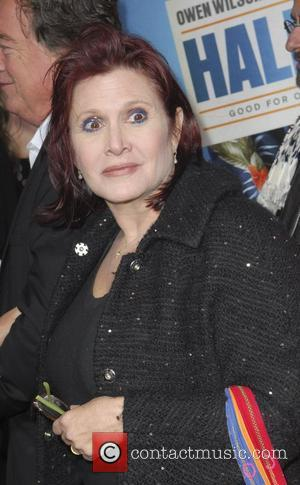 Carrie Fisher  Los Angeles Premiere of Warner Bros. Pictures' Hall Pass held at the Cinerama Theatre Los Angeles, California...
