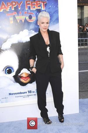Alecia Moore aka Pink,  at Warner Bros. World Premiere of 'Happy Feet Two' at Grauman's Chinese Theatre. Hollywood, California...