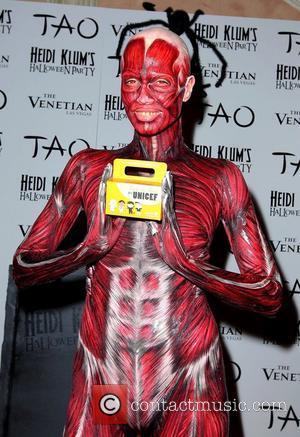 Heidi Klum Stuns As Fleshy Fiend