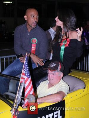 Montel Williams and Guest The 80th Anniversary of The Hollywood Christmas Parade benefiting Marine Toys For Tots on Hollywood Boulevard...