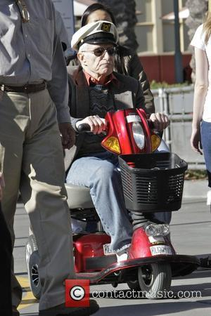 Hugh Hefner riding a mobility scooter whilst enjoying a day out at Disneyland  Los Angeles, California - 21.04.11
