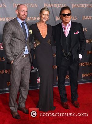 Guest, Mickey Rourke and Anastassija Makarenko 'Immortals 3D' Los Angeles premiere at Nokia Theatre L.A. Live  Los Angeles, California...