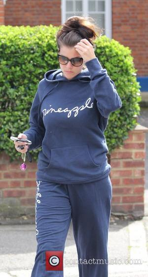 Imogen Thomas is seen leaving her home in a workout suit and sunglasses London, England - 18.06.11