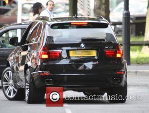 Jack P. Shepherd's BMW appears to have a nasty dent on the back bumper Coronation Street cast members outside the...