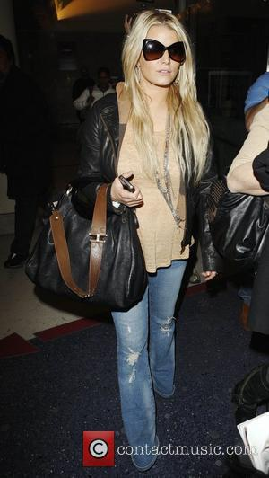 Jessica Simpson arrives at LAX airport Los Angeles, California - 26.03.11