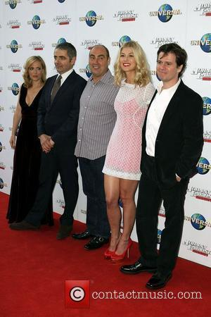 (l-r) Gillian Anderson, Rowan Atkinson, Oliver Parker (Director), Rosamund Pike, Chris Clark (Producer) The world premiere of 'Johnny English Reborn'...