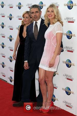 (l-r) Gillian Anderson, Rowan Atkinson, Rosamund Pike The world premiere of 'Johnny English Reborn' held at Hoyts Cinema Sydney, Australia...
