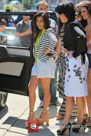 Kourtney Kardashian, Kris Jenner Kim Kardashian's family wait along with Vera Wang for the reality TV star to arrive at...
