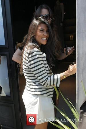 Kourtney Kardashian Kim Kardashian's family wait along with Vera Wang for the reality TV star to arrive at a wedding...