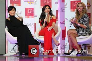 Kris Jenner, Kim Kardashian and Joelle Mardinian Kim Kardashian and Kris Jenner appear on a catwalk in the middle of...