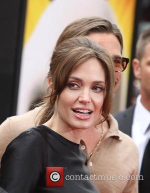 Jolie: 'My Kids Help Me Shed Hard Shell'