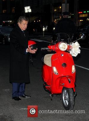 Regis Philbin is given a Vespa scooter by David Letterman 'The Late Show with David Letterman' at the Ed Sullivan...