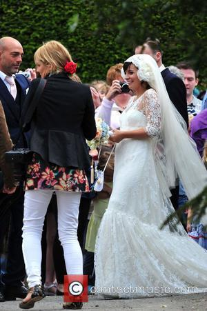 Sam Cooper and Lily Allen emerge as husband and wife The wedding of Lily Allen and Sam Cooper Cranham, Gloucestershire...