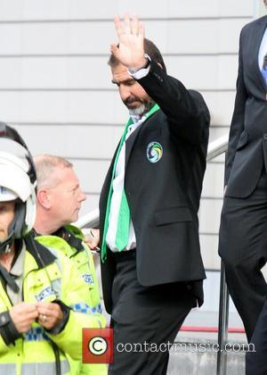 Eric Cantona gives a wave as he leaves the Lowry Hotel to watch the Manchester United vs New York Cosmos...
