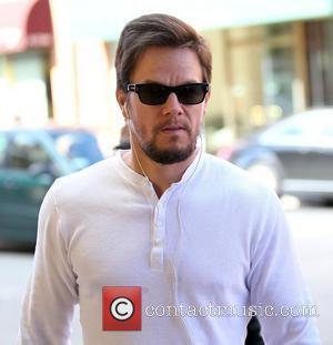 Mark Wahlberg  holding hands with his wife, as they arrive at a medical centre in Beverly Hills Los Angeles,...