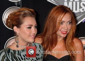 Miley Cyrus, sister  2011 MTV Video Music Awards held at LA Live - Arrivals Los Angeles, California - 28.08.11