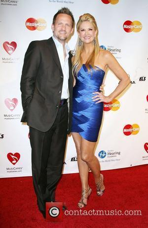 Nancy O'Dell and Keith Zubulevich 2011 MusiCares Person of the Year Tribute to Barbara Streisand held at the Los Angeles...