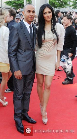 Lewis Hamilton and Nicole Scherzinger,  National Movie Awards held at the Wembley Arena - Arrivals.  London, England -...