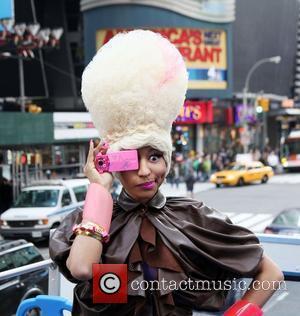 Nicki Minaj in Times Square on an open top double decker bus  Casio Teams up with Nicki Minaj and...
