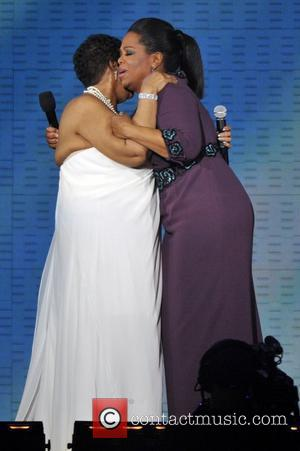 Aretha Franklin and Oprah Winfrey  during Surprise Oprah! A Farewell Spectacular at the United Center in Chicago Chicago, Illinois...